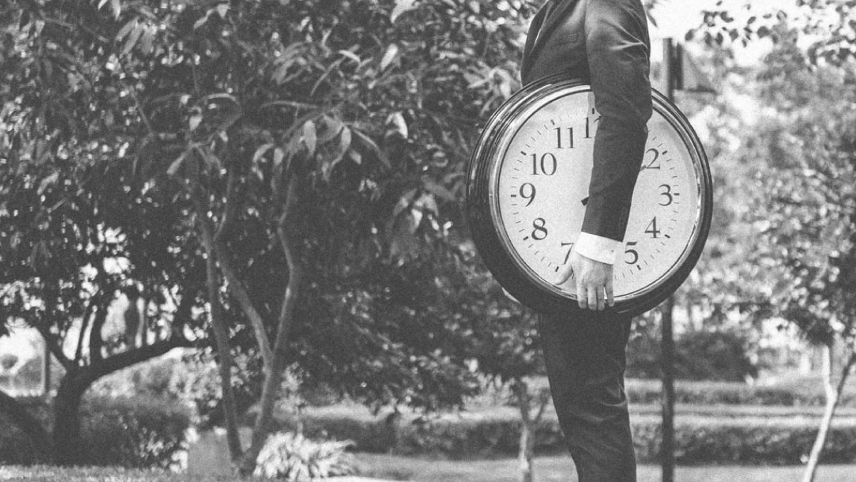 Person Holding Clock